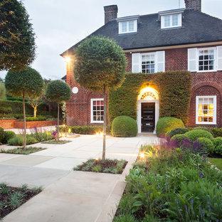 Inspiration for a traditional full sun formal garden in London.