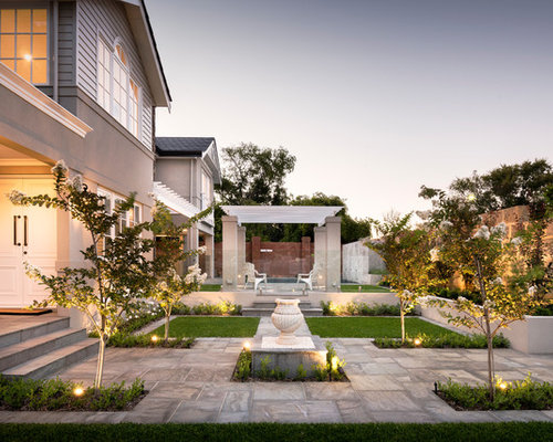 Houzz 50 best traditional garden pictures traditional garden design ideas for a mid sized traditional formal garden in perth with a water feature workwithnaturefo