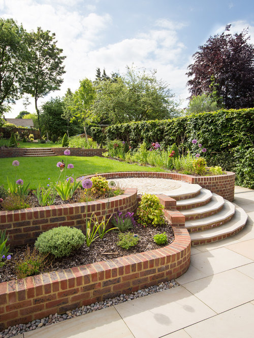 photo of a large traditional full sun landscaping in hertfordshire - Retaining Wall Design Ideas