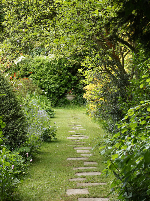 garden paths and stepping stones. photo of a large traditional partial sun backyard stone garden path in hampshire. paths and stepping stones