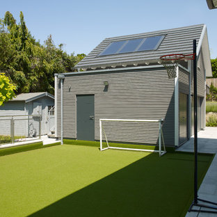 Inspiration for a contemporary back garden in Cambridgeshire with an outdoor sport court.
