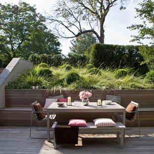 Medium sized modern back formal garden in London with decking.
