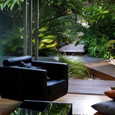 Inspiration for a small contemporary front yard water fountain landscape in Perth with decking.