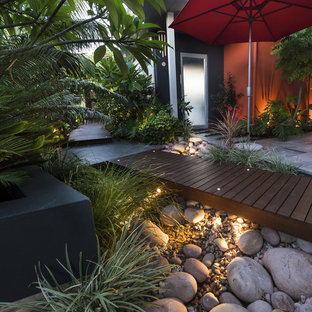 Photo of a small contemporary partial sun courtyard water fountain landscape in Perth with decking.