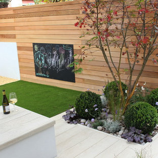 Photo of a small contemporary back partial sun garden in London with decking.