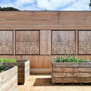Design ideas for a contemporary full sun garden in Melbourne with a vegetable garden and gravel.