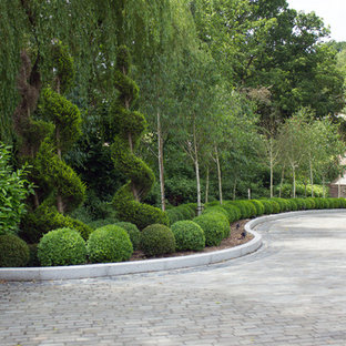 Inspiration for a huge shabby-chic style backyard driveway in Kent.