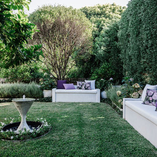 Photo of a transitional backyard formal garden in Sydney with a water feature.