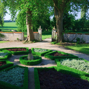 Design ideas for a traditional formal garden in London with gravel.