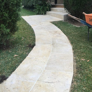 Inspiration for a large contemporary front yard concrete paver landscaping in Sydney.