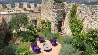 Mediterranean Walled Garden With Bright Furniture