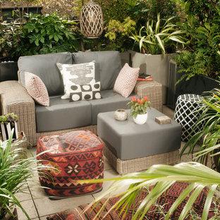 Inspiration for a medium sized modern roof xeriscape full sun garden in London.