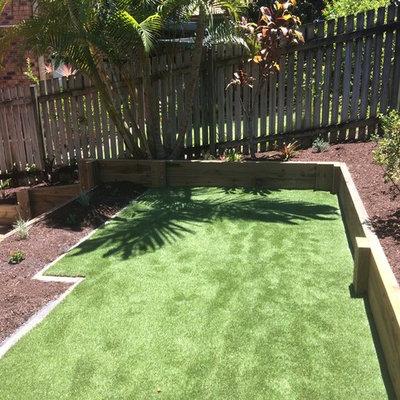 Inspiration for a small contemporary backyard formal garden in Brisbane.