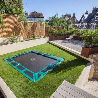 Inspiration for a medium sized contemporary back garden in Hampshire with decking.