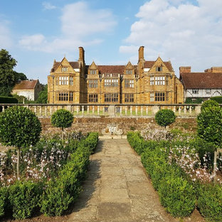 Design ideas for a classic formal garden in London with a garden path and concrete paving.