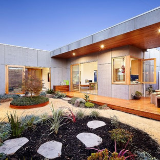 Inspiration for a contemporary courtyard formal garden in Melbourne with a garden path and gravel.