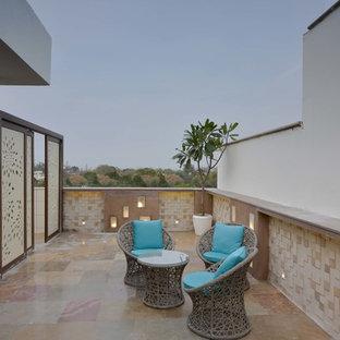Immagine di un giardino design esposto a mezz'ombra di medie dimensioni e sul tetto con pavimentazioni in cemento