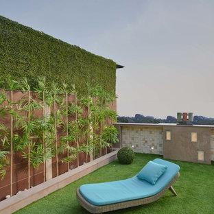 Réalisation d'un jardin sur toit design de taille moyenne avec une exposition partiellement ombragée.