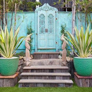 Traditional backyard partial sun garden in Brisbane with a container garden.