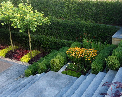 75 sloped garden design ideas stylish sloped garden remodeling inspiration for a contemporary sloped garden in cheshire with a retaining wall and natural stone paving workwithnaturefo