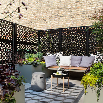 Porcelain paving with a tile inlay to zone the comfortable seating