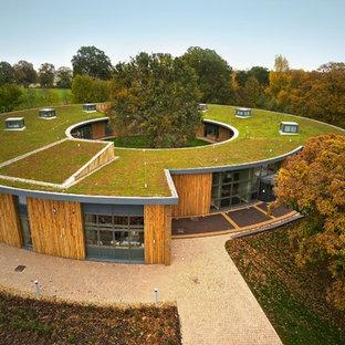 Ispirazione per un grande giardino formale country esposto in pieno sole sul tetto in autunno con pacciame