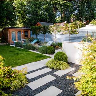 Medium sized contemporary back full sun garden for summer in Manchester with natural stone paving and a garden path.