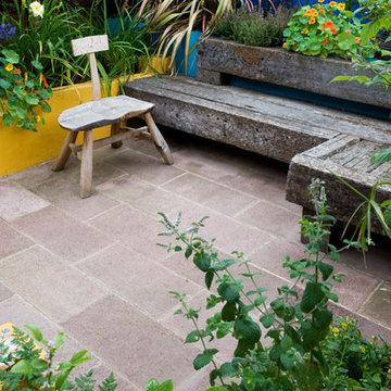 Railway sleeper seating, rendered raised bed, terracotta sandstone paving
