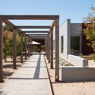 Photo of a contemporary partial sun garden in Melbourne with decking.
