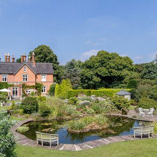 Inspiration for a traditional back full sun garden in Cheshire with a pond.