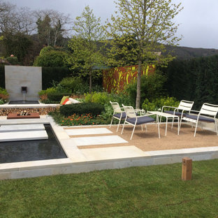 Inspiration for a medium sized contemporary formal garden in Gloucestershire with a waterfall.