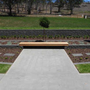 Inspiration for a huge farmhouse full sun front yard brick landscaping in Sydney for summer.