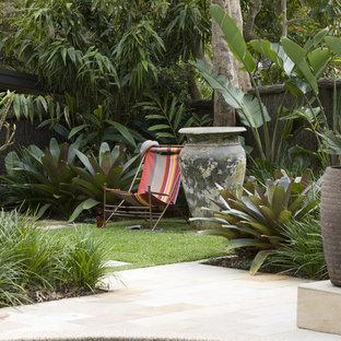 Inspiration pour un jardin arrière ethnique.