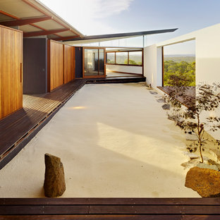 This is an example of an asian full sun landscaping in Sydney with decking.