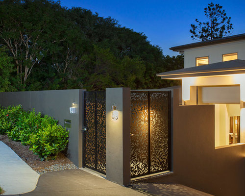 mid sized modern front yard garden in brisbane with a garden path and natural stone