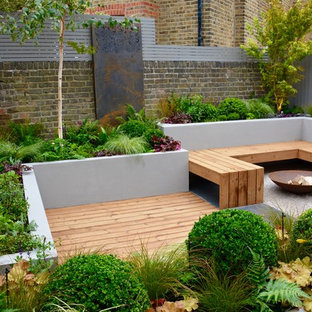 This is an example of a small contemporary back partial sun garden in London.