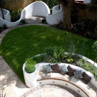 Design ideas for a large contemporary backyard stone formal garden in London.
