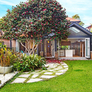 Traditional backyard garden in Sydney with natural stone pavers.