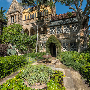 This is an example of a traditional formal garden in Sydney with a garden path and gravel.