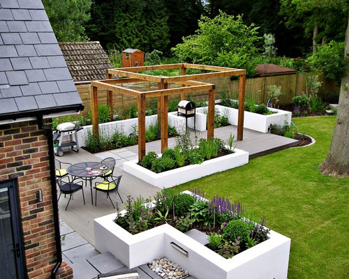 Photo Of A Contemporary Back Patio In London With Decking