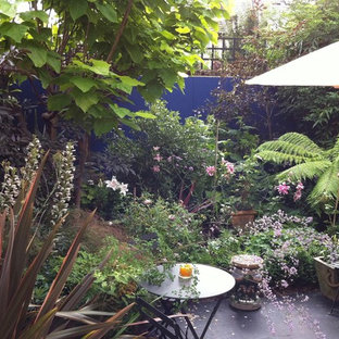 This Is An Example Of A Small Tropical Partial Sun Backyard Landscaping In London For Summer