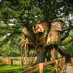 Rustic garden in Other with a climbing frame.