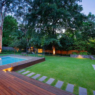 Photo of a mid-sized contemporary backyard landscaping in Sydney.