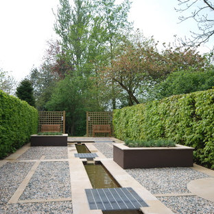 Inspiration for a contemporary formal full sun garden in Other with gravel.