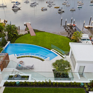 This is an example of a huge contemporary full sun backyard water fountain landscape in Sydney.