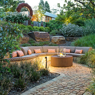 Design ideas for a mid-sized contemporary backyard landscaping in Melbourne with a fire pit.