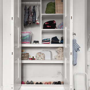 This is an example of a small midcentury gender-neutral built-in wardrobe in Gothenburg.