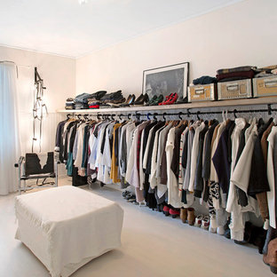 Large scandinavian gender-neutral dressing room in Other with open cabinets and light hardwood floors.