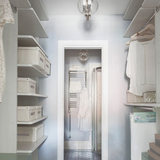 Inspiration for a small traditional women's walk-in wardrobe in Moscow with open cabinets, ceramic floors, multi-coloured floor and beige cabinets.