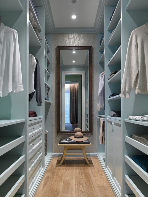 Walk In Closet Small Transitional Gender Neutral Medium Tone Wood Floor And Brown